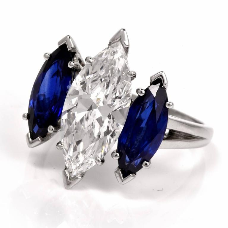 This incredible Oscar Heyman ring is the epitome of sparkle, color, and luxurious elegance! Finely crafted in solid platinum, it is centered with one genuine GIA graded marquise cut diamond approximately 4.19ct, E color, VS2 clarity. The center
