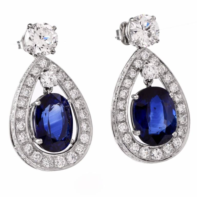 These classically sophisticated pendant earrings of unsurpassed elegance incorporate pear-shaped profiles, are crafted in solid platinum and weigh approx. 12.2 grams. They expose a pair of eye-catching GIA certified cushion-cut genuine blue