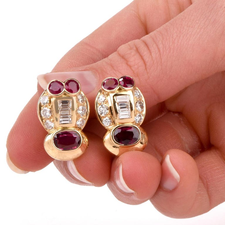 These stylish 1980's earrings are crafted in 18K yellow gold, featuring 6 genuine vibrant rubies weighing approx. 4.75 carats in total. They are set with very high grade round and 6 baguettes diamonds weighing approx 2.20 carats total grade F-G
