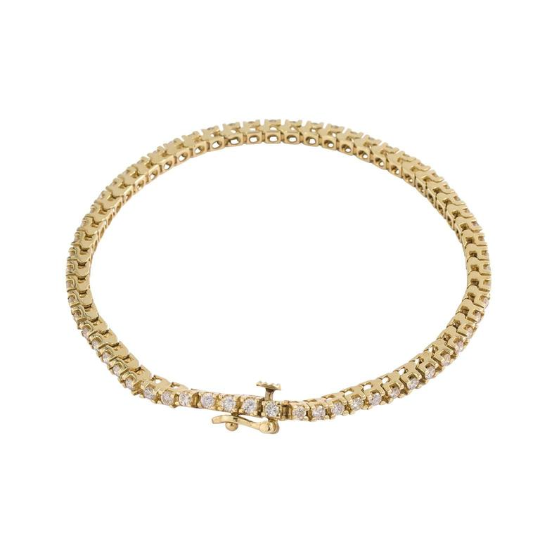 14 Karat Gold And Diamond Tennis Bracelet At 1stdibs