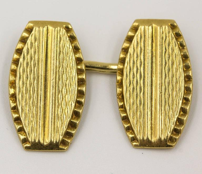 Vintage cuff links made from solid 18 KT yellow gold. Marked 750 for gold content. Lovely guilloche patterns on top. Double sided. Connected with links. Easy to wear. Weighs 10 grams total.