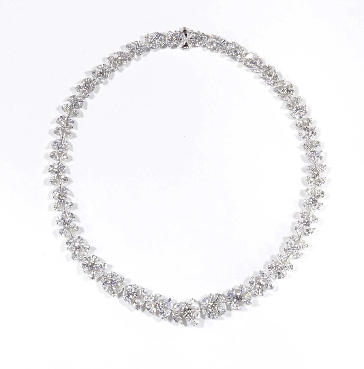 The most elegant diamond necklace!  51.14 carats of F-G color VS clarity diamond set in platinum.  This exquisite piece is handmade in New York.