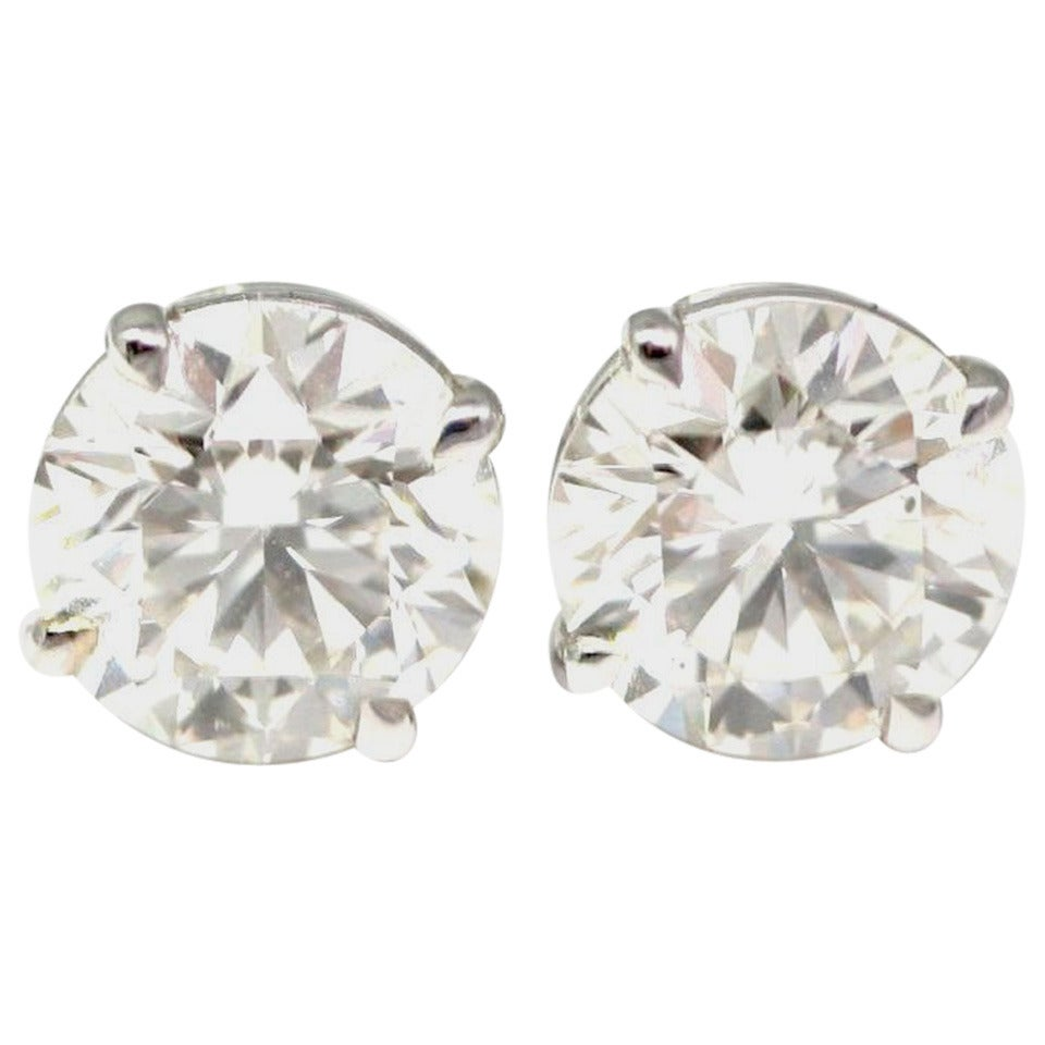 2.51 and 2.65 Carat Diamond Gold Ear Studs For Sale