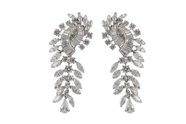 BOUCHERON Pair of pendants earrings in foliated white gold set with twelve carats of diamonds in baguette, round, navette and pear cut, one 0.45 carat E/VS2, the other 0,47ct F/VS2, certified HRD signed and numbered 36189, in its Boucheron box (22,7