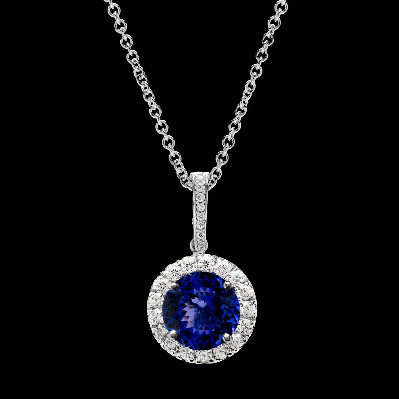 Tanzanite diamond gold halo pendant necklace for sale at 1stdibs one round brilliant cut tanzanite for approximately 601 carats prong set in an 18kt white gold contemporary tanzanite diamond gold halo pendant mozeypictures Images