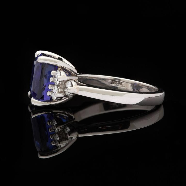4 14 carat cushion cut tanzanite platinum ring at