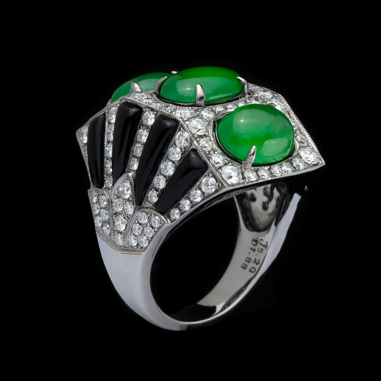 Exclusive New York-based Taiwanese jeweler Anna Hu created this amazing ring. The fan-shaped 18k white gold ring is designed with 3 oval-shaped jadeite jade cabochons, weighing together 5.20 carats, and accented with black onyx and round