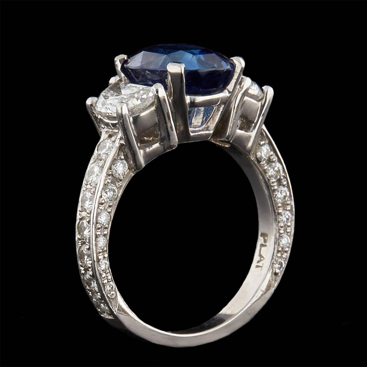 Contemporary Vivid No Heat Madagascar Blue Sapphire Diamond Ring For Sale