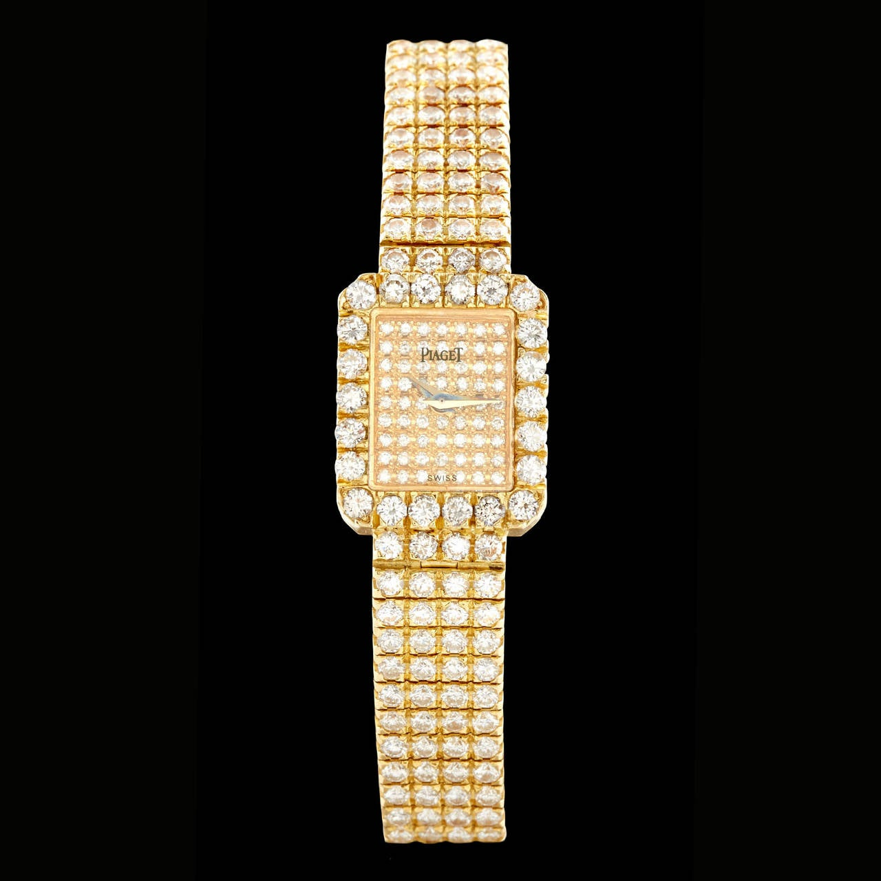 Stunning Piaget Ladies Diamond Watch set in 18Kt Yellow Gold. 332 round brilliant cut diamonds are set beautifully on the entire front of the watch totaling a carat weight of 8.60-ctw. The case measures 18mm x 14.5mm with a bracelet length of 6.5