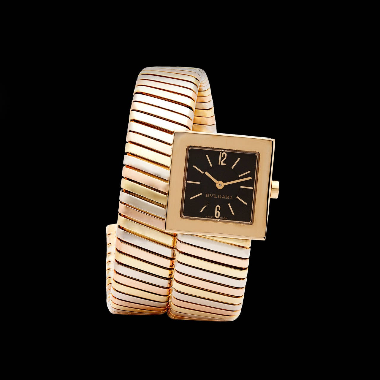 Bulgari 18Kt Yellow, White, and Rose Gold Bracelet Watch from the Serpenti collection. This duo purpose jewelry piece is a quartz movement timepiece and bracelet that comfortably wraps around the wrist. The wrist size is 6 inches in circumference,