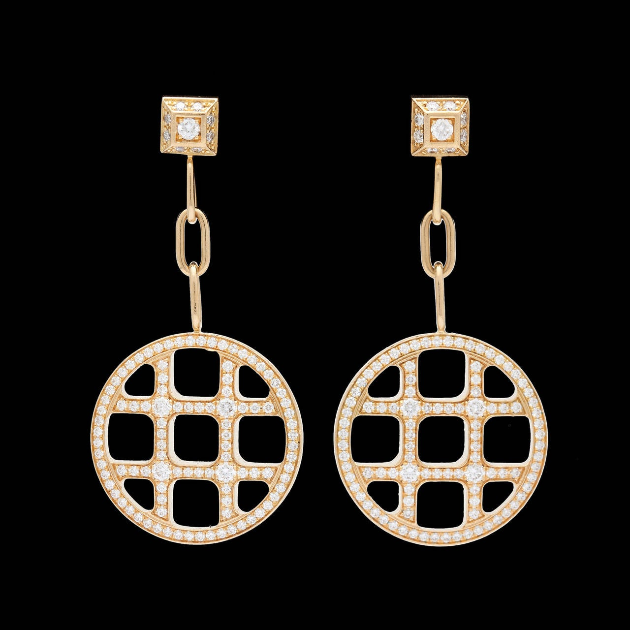 Pasha de Cartier 18Kt Yellow Gold Earrings Feature 228 Round Brilliant Cut Fine Diamonds for Approximately 1.40 Carat Total Weight. These light weight earrings hang approximately 1.5 inches and weigh 16.3 grams total.