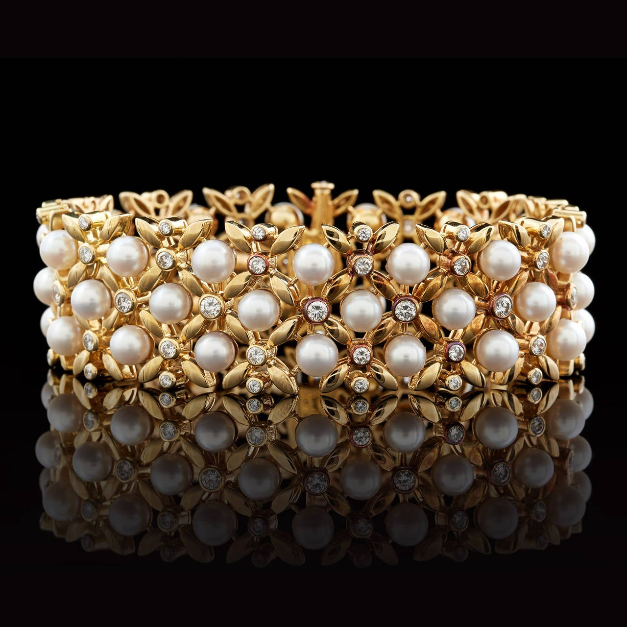 A Fantastic Vintage Tiffany & Co. 18Kt Yellow Gold Bracelet with Floral Links Detailed in 5.5 to 6.0mm Round Cultured Pearls and 75 Round Brilliant Cut Diamonds Totaling Approximately 2.37 Carats. The bracelet measures 7.5 inches long and 0.88