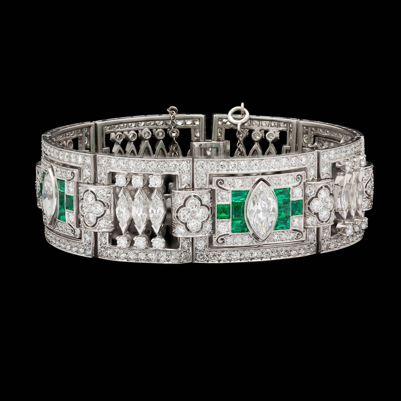 Stunning Art Deco Platinum Link Bracelet Adorned with Marquise and Round Cut Diamonds and 24 Vibrant Emeralds. The three largest marquise cut diamonds total approximately 3.35cts and average G color and SI clarity. The remaining diamonds total