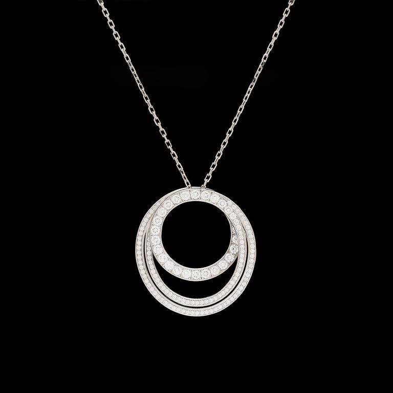 Cartier 18k white gold Paris Nouvelle Vague necklace set with 140 round brilliant cut diamonds totaling 1.15 carats.  Pendant is 1