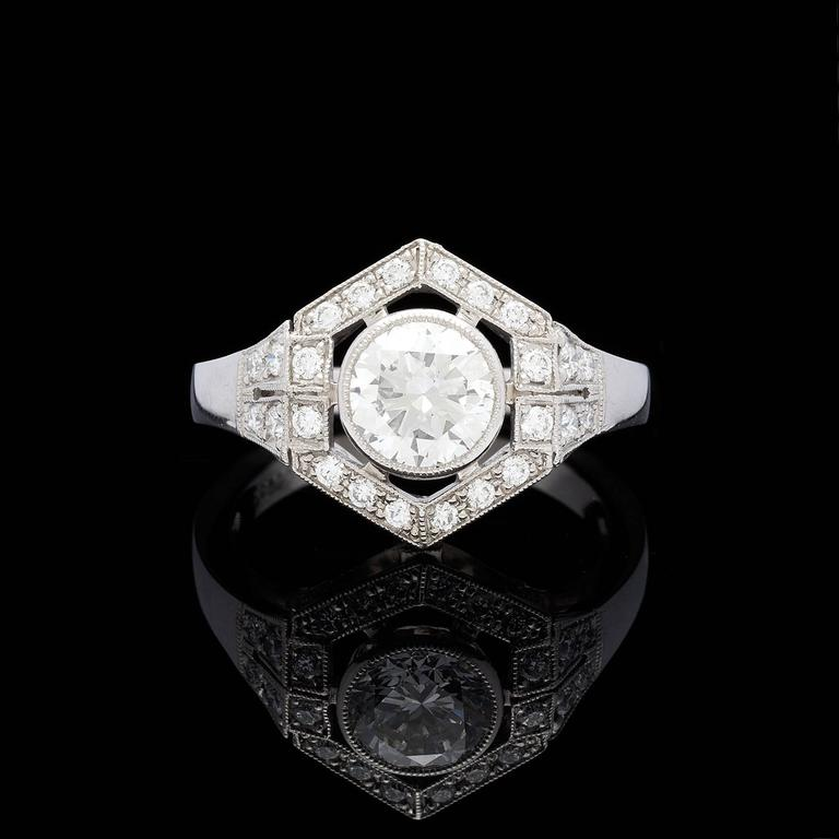 Gorgeous platinum Art Deco style diamond ring features a center 1.18 carat I/SI1 round brilliant cut diamond.  GIA report # 5172209745 accompanies the diamond.  Accenting the ring are 30 round brilliant diamonds totaling 0.38 carats, detailed with