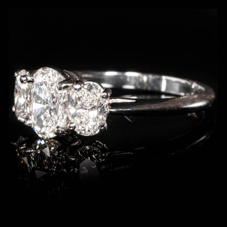 Tiffany and Co Oval Brilliant Cut Diamond Platinum Three Stone Ring at 1stdibs
