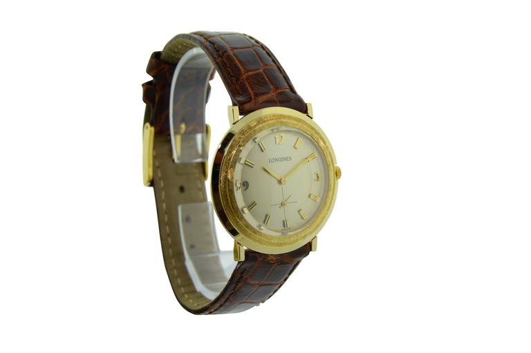 FACTORY / HOUSE: Longines Watch Company STYLE / REFERENCE: Round / Moderne METAL / MATERIAL: 14Kt. Solid Yellow Gold DIMENSIONS:  34mm  X  33mm CIRCA:   MOVEMENT / CALIBER: 17 Jewels / Manual Winding DIAL / HANDS: Original Silvered / Baton