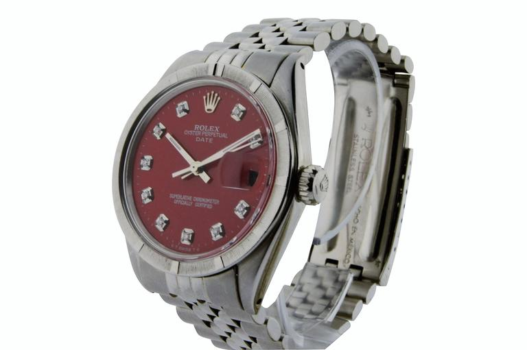 FACTORY / HOUSE: Rolex Watch Company STYLE / REFERENCE: Oyster Perpetual / Date / Ref. 1500 METAL / MATERIAL: Stainless Steel DIMENSIONS:  39mm  X  34mm CIRCA: 1970's MOVEMENT / CALIBER: Perpetual / 26 Jewels / Cal. 1570 DIAL / HANDS: Replace Red