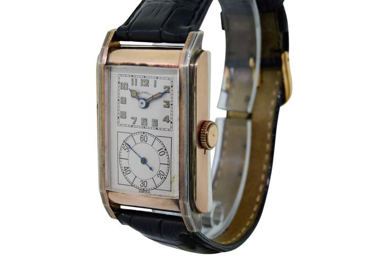 FACTORY / HOUSE: J.E. Cardwell STYLE / REFERENCE: Drs. Double Dial  METAL / MATERIAL: Silver and Rose Gold DIMENSIONS:  45mm X 27mm CIRCA: 1930's MOVEMENT / CALIBER: Manual Winding / 15 Jewels DIAL / HANDS: Luminous Arabic Numbers / Blued Steel