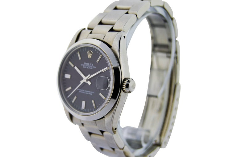 FACTORY / HOUSE: Rolex Watch Company STYLE / REFERENCE: Oyster Perpetual / Midsize METAL / MATERIAL: Stainless Steel  DIMENSIONS: 35mm X 30mm CIRCA: 2000 plus MOVEMENT / CALIBER: Perpetual Winding / 26 Jewels  DIAL / HANDS: Original Black with Baton
