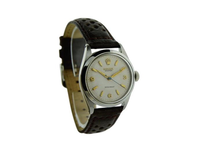 FACTORY / HOUSE: Rolex Watch Company STYLE / REFERENCE: Oyster / Art Deco METAL / MATERIAL: Stainless Steel DIMENSIONS: 38mm X 32mm CIRCA: 1955 / 1956 MOVEMENT / CALIBER: Manual Winding / 17 Jewels  DIAL / HANDS: Original Silvered Gilt Baton Markers