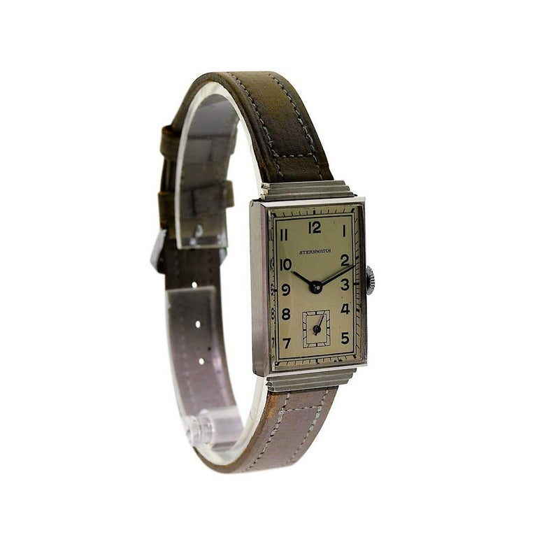 FACTORY / HOUSE: Sternwatch STYLE / REFERENCE: Rectangle / Art Deco METAL / MATERIAL: Stainless Steel DIMENSIONS: 35mm X 20mm CIRCA: 1930's MOVEMENT / CALIBER: Manual Winding / 15 Jewels  DIAL / HANDS: Original Arabic Number / Blued Steel Baton