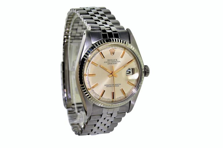 FACTORY / HOUSE: Rolex Watch Company STYLE / REFERENCE: Datejust / 1601 / Machined Bezel METAL / MATERIAL: Stainless Steel DIMENSIONS:  43 mm  X 36  mm CIRCA: 1960's MOVEMENT / CALIBER:  Perpetual Winding / 26 Jewels / Cal. 1570 DIAL / HANDS: