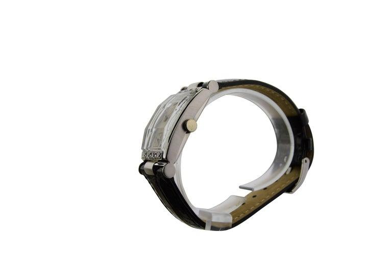 FACTORY / HOUSE: Hamilton Watch Company STYLE / REFERENCE: Art Deco Gabled Crystal Diamond Bezel METAL / MATERIAL:  CIRCA: 1940's Platinum DIMENSIONS:  40mm  X  21mm MOVEMENT / CALIBER: 17 Jewels / Tonneau Shape DIAL / HANDS: Original / Diamond