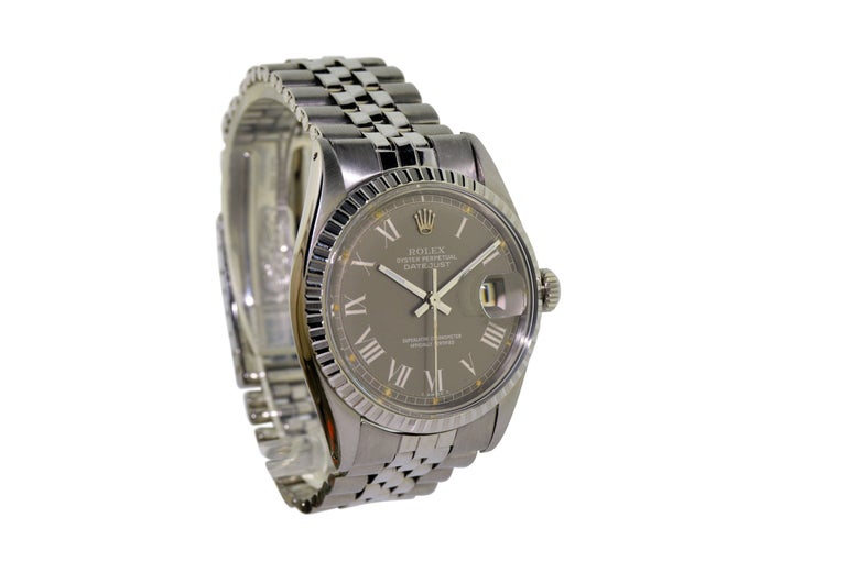 FACTORY / HOUSE: Rolex Watch Company STYLE / REFERENCE: Datejust / 1603 / Machined Bezel METAL / MATERIAL: Stainless Steel DIMENSIONS:  43 mm  X 36  mm CIRCA: 1974 / 1975 MOVEMENT / CALIBER:  Perpetual Winding / 26 Jewels / Cal. 1570 DIAL / HANDS: