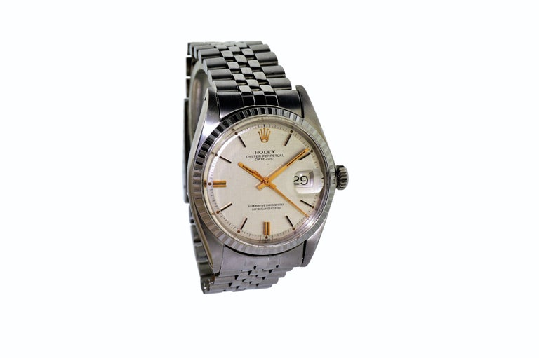FACTORY / HOUSE: Rolex Watch Company STYLE / REFERENCE: Datejust / Ref. 1601 METAL / MATERIAL: Stainless Steel  DIMENSIONS:  44mm  X  36mm CIRCA: late 1960's MOVEMENT / CALIBER: Perpetual Winding / 26 Jewels / Cal.1570 DIAL / HANDS: Original Linen /