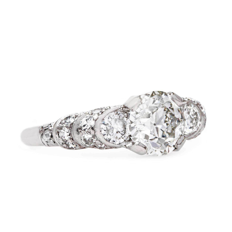 gleaming platinum deco engagement ring with unique