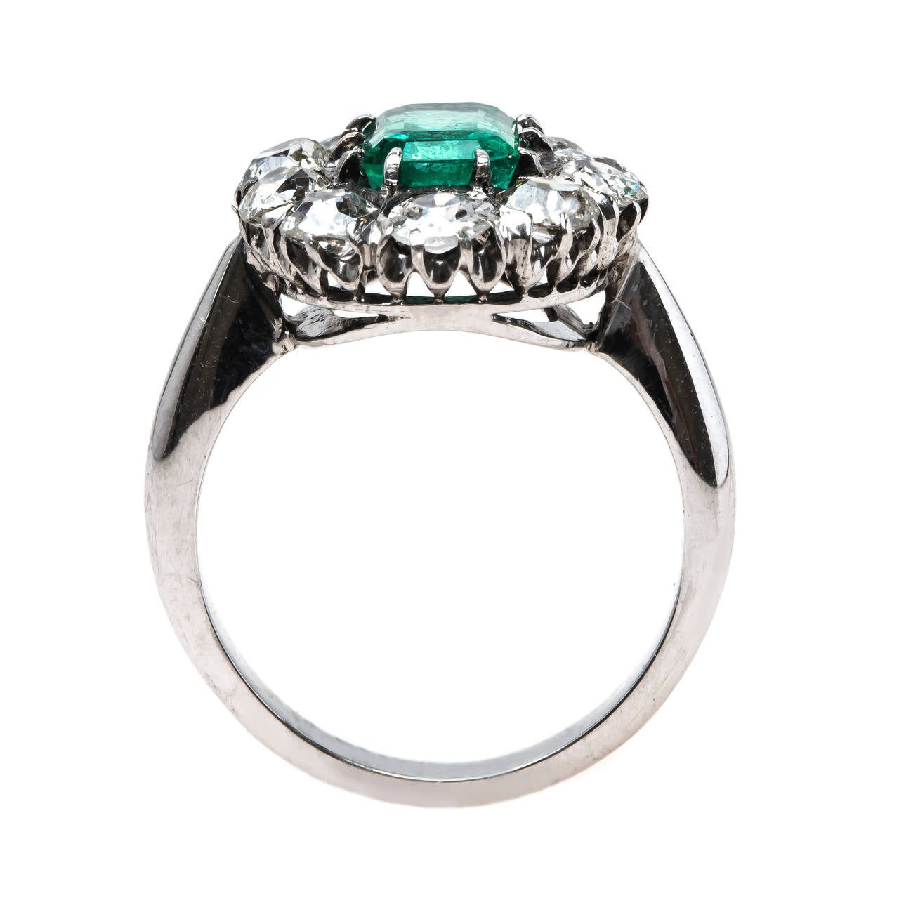 columbian emerald engagement ring with sparkling mine