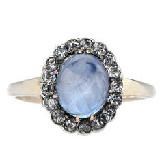 Dreamy Oval Cabochon Sapphire Engagement Ring with Diamond Halo