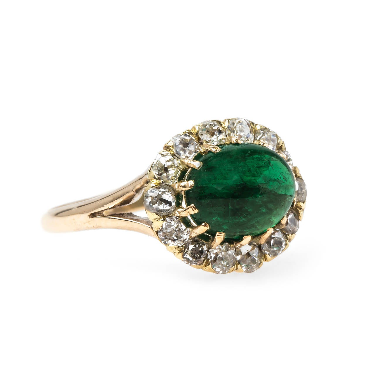 cabochon emerald gold engagement ring at