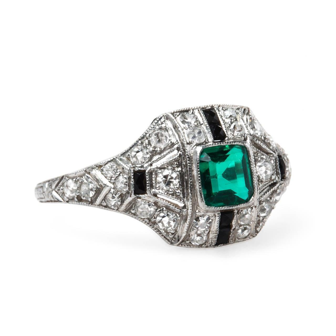 fantastically unique deco onyx emerald ring at