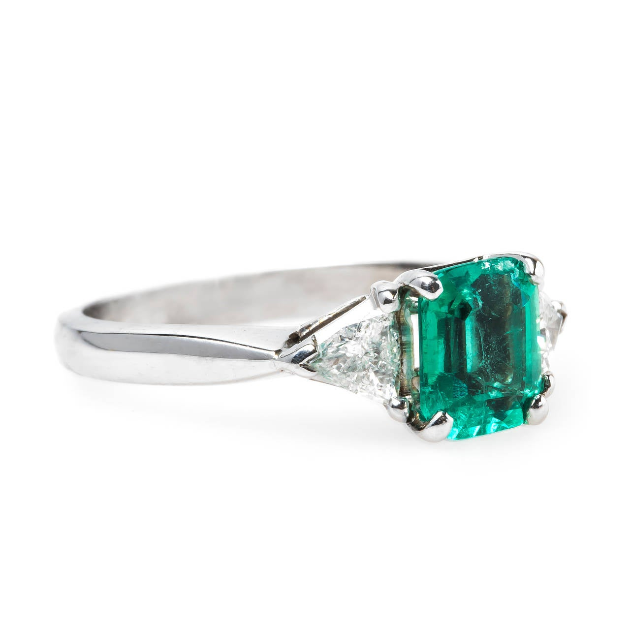 modern emerald gold engagement ring at