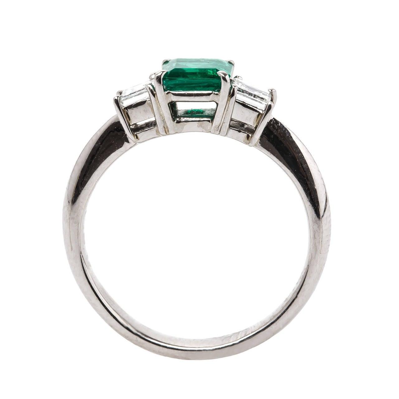 contemporary platinum emerald engagement ring at