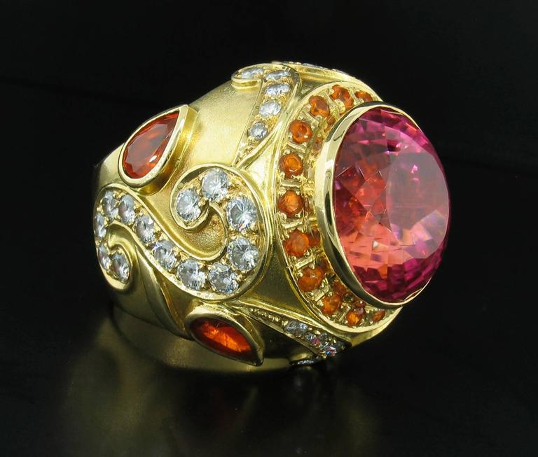 California Tourmaline, Garnet and Diamond Ring; This ring was designed and made by well known designer Paula Crevoshay.  It features an incredible, rare California Pink Tourmaline weighing 25.61 carats, Garnets weighting 3.60carats and Diamonds