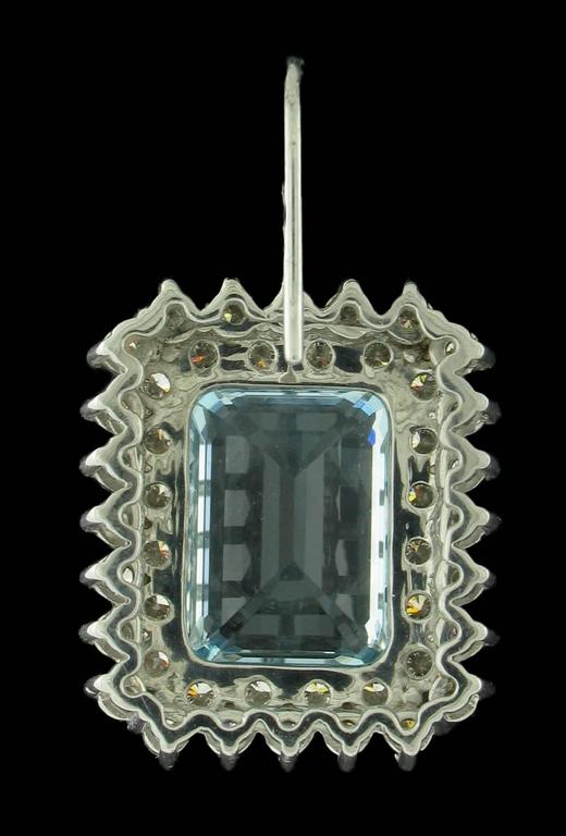 Gorgeous Aquamarine and Diamond earrings feature 14.20 carats in Aquamarine and 4.55 carats in Diamonds.  Shepherds hook post tops.  18k gold settings.  Matching ring available.  Regular Price $10,800
