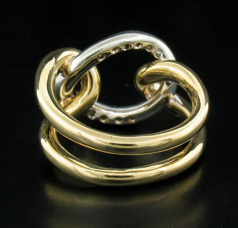 18k yellow and white gold with pave set round brilliant Diamonds. Hallmarked 'Italy' and 'C237AL'.  Approximately 0.25 carats of Diamonds. Size 4 1/2
