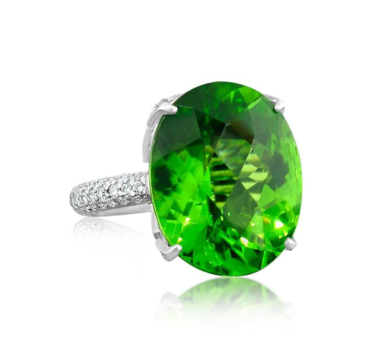Burmese Peridot is the most desirable of it's kind in the world.  This outstanding example weighs 16.42 carats.  It is set in a gorgeous platinum setting pave set with 1.50 carats in Diamonds.  Size 7 1/2. **This ring may be resized to fit after