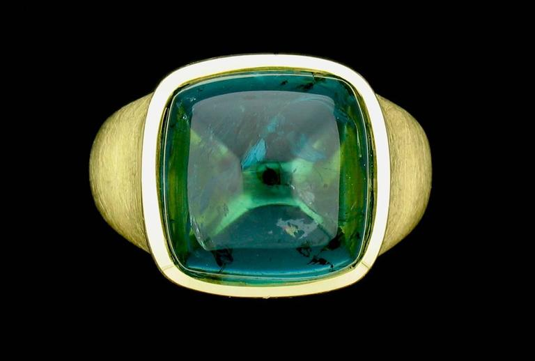 This ring features a fabulous 16.87 carat Blue-Green Tourmaline in a sugarloaf cut.  The setting is a brushed gold.  Size 7.  This is a slae item.  Regular price $16,600