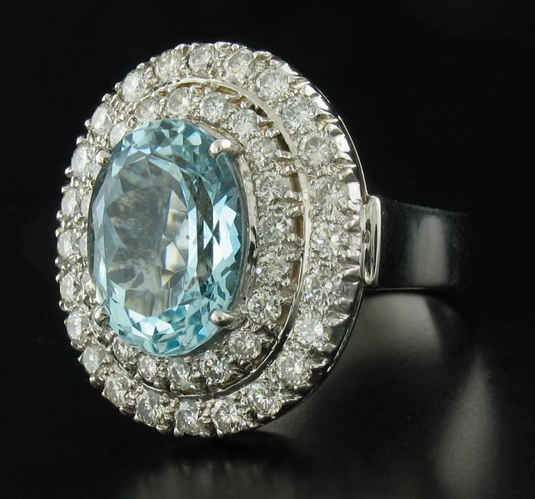 Gorgeous Aquamarine and Diamond ring feature a large oval Aquamarine weighing 8.0 carats and is surrounded by 2 rows of Diamonds weighing 2.16 carats.  18k white gold setting.  Size 8 1/4.  Stamped 750.  Matching earrings available.Regular Price