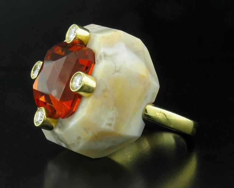 Designer Nicholas Varney's Signature 'Duo' Ring features a banded agate base with a stunning 15.55ct Square Step-cut Spessartite of the highest quality.  Spessartite in this color is very rare.  In fact, the only rarer garnet is the Demantoid.  This