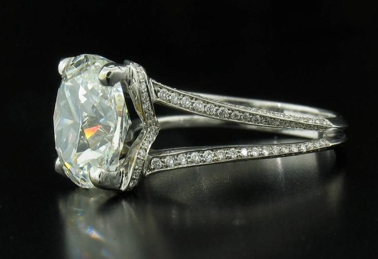 This is a spectacular Diamond Ring featuring a 5.01 carat, ideal cut, Cushion stone, hand selected by us. It is an G - VS2 with a GIA laboratory report.  Diamond pave on the 18k white gold setting weighs a total of 0.45 carats.  It is stamped 750.
