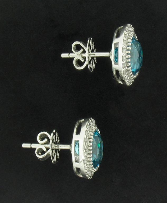 Natural Blue Zircon Stud Earrings Feature Oval Zircons Weighing A Total Of 6 96 Carats With