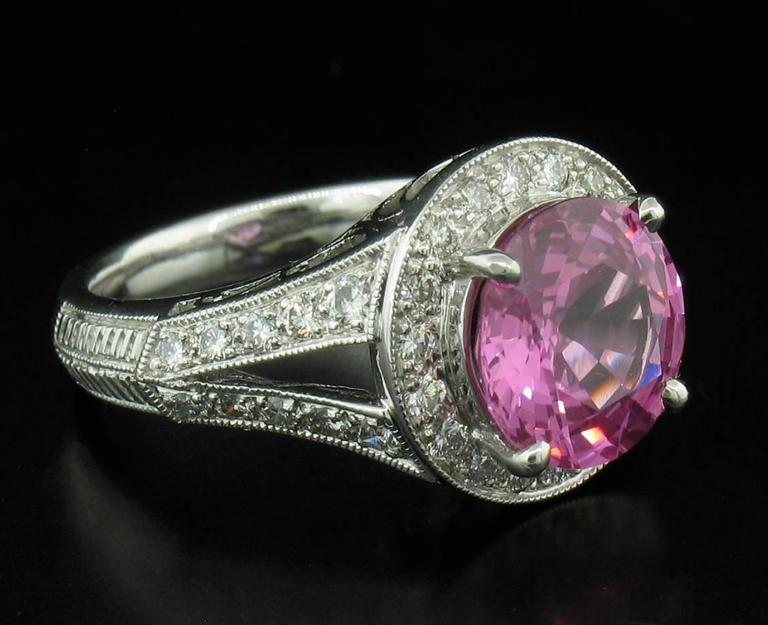This stunning pink sapphire weights 3.53 carats and is accented by fully faceted diamonds weighing a total of 0.55 carats in a platinum setting.  Size 4 1/2. **This ring may be resized to fit after purchase at no cost to the buyer.