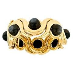 John Landrum Bryant: 18k Gold 99.3ct. Black Moonstone Snail Bracelet