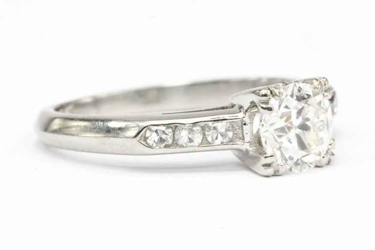 Era: Art Deco   Hallmark: 10% Irid Plat.  Composition: Platinum  Primary Stone: Diamond  Stone Carat: Approximately .75 CT   Color: F  Clarity: Vs2  Cut: Old European Cut   Secondary Stone: Diamond  Secondary Stone Carat Weight: .15 CT  Secondary