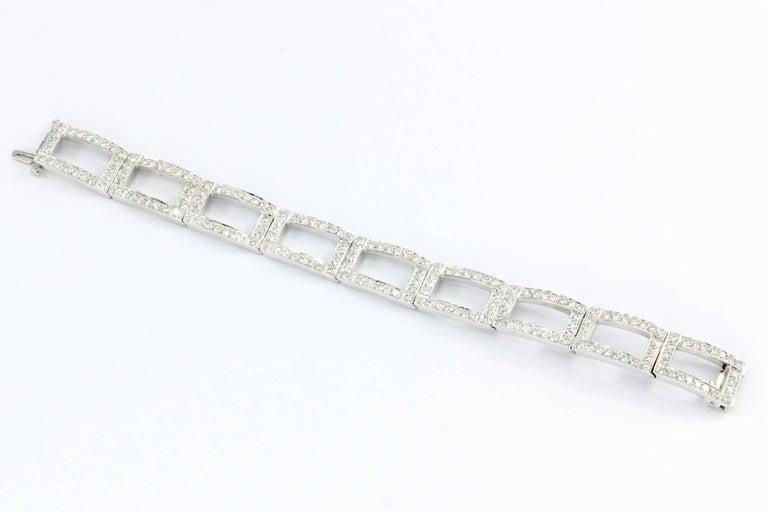 Era: Modern  Composition: 18K White Gold  Primary Stone: Diamond  Stone Carat: Approximately 8 CTW  Color: D/E  Clarity: VVS1/VVS2  Shape: Round Brilliant  Bracelet length: 6.75